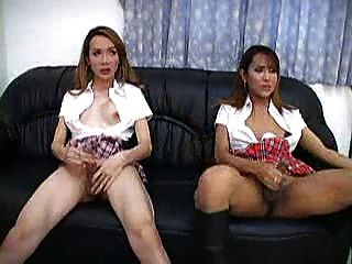 2 trannies wanking
